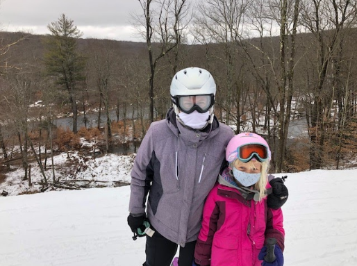Photo of Dr Matelis enjoying some time on the ice with her kid