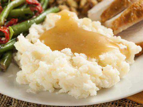 Photo of mash potatoes and gravy