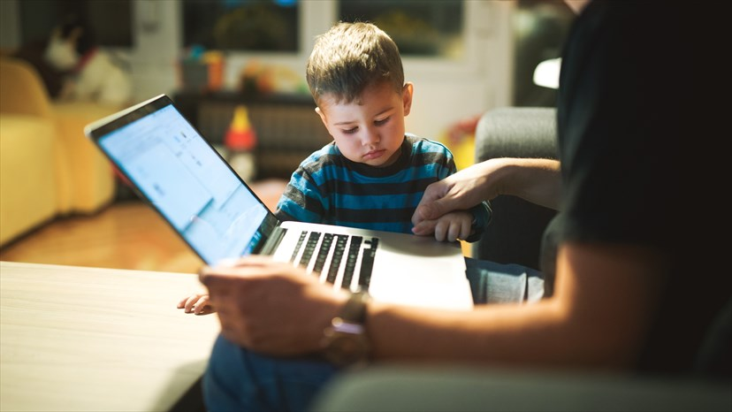 Parent and toddler with laptop